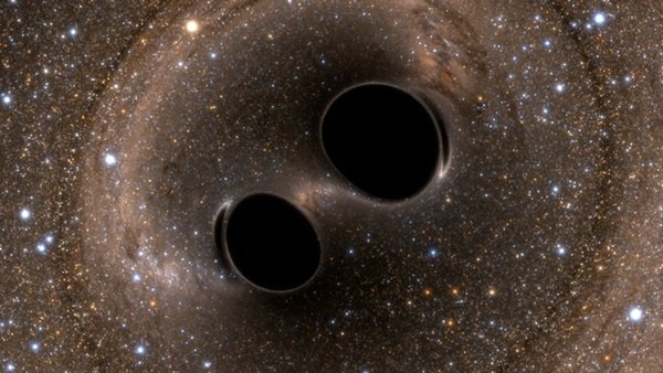 black_hole_collision_and_merger_releasing_gravitational_waves145150449.jpg